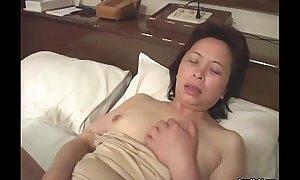 Oriental granny masturbates